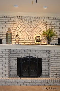 Very busy day today!! I decided a few days ago that my next DIY project would be to paint the brick fireplace. I ...