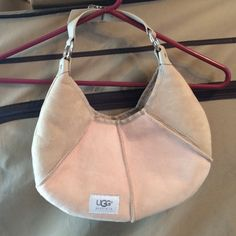 Ugg Tan and Pink Hobo Bag BRAND NEW UGG Tan and Pink Hobo Bag, brand new with tag inside of bag (not attached). Dust bag included. UGG Bags Hobos