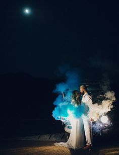 Wedding Photo with Blue and White Smoke Bombs