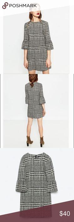 Zara Frilled Sleeve Dress Brand new with tags. Never worn. Description: Color: Ecru / Black. Composition: 76% polyester, 22% viscose, 2% elastane. Zara Dresses Midi