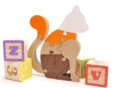 Brown and Orange Wooden Cat Puzzle and Kids Room Decor by Berkshire Bowls and Toys, $24.99 USD