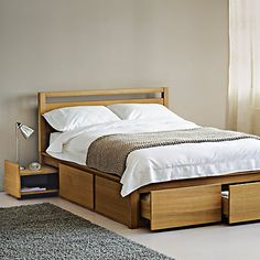 Buy John Lewis Sullivan Storage Bed, Double Online at johnlewis.com This bed but without headboard is £950, £1095 with (ouch). 4 deep drawers and hideaway bedside tables (cool)