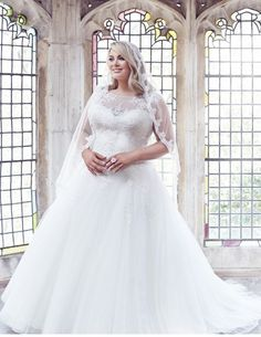 Illusion neckline wedding gowns like this one can be made for a bride of any size or shape.  You can gather pricing and more details on custom #plussizeweddingdresses & replica dresses when you visit our main website.