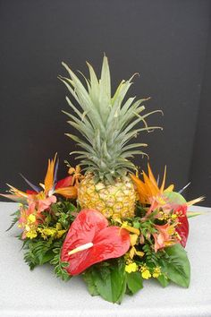 I like this with the pineapple and tropical, orange-ish flowers Hawaiian Centerpieces, Tropical Wedding Centerpieces, Pineapple Centerpiece, Tropical Floral Arrangements, Fruit Centerpieces, Beach Wedding Decorations, Centerpiece Decorations, Flower Arrangements, Tropical Weddings