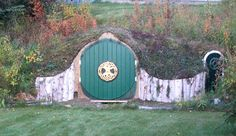 "Backyard hobbit holes aren't just for kids. This one, in Kenai, Alaska, is used as a shed for garden tools. ""My uncle brought me a piece of culvert which we installed in a hill on my property. After enclosing, covering with moss, and adding doors and art (and a ""side door""), the illusion is coming together. Still have a bit of stone work to do, but the overall effect is there,"" says creator R. Estelle.  ♥"