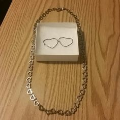 Stainless steel Stainless steel, very cute, about 14 inch long necklace. Heart shaped necklace with heart shaped earrings. Jewelry