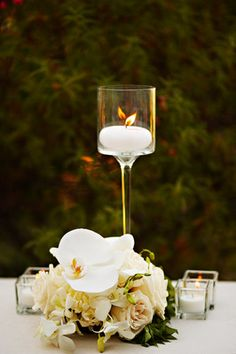 Simple white candles served as elegant accent pieces. (Photo by Geoff White Photographers)