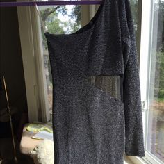 Black/metallic one shoulder dress size small Really cute one shoulder black and silver metallic midi dress with see through gap around the stomach. Love Culture Dresses One Shoulder