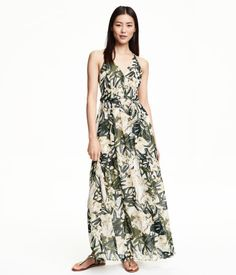 Long, sleeveless dress in airy chiffon with a printed pattern. V-neck at front with covered buttons. Narrow shoulder straps that cross at back and concealed back zip. Lined.