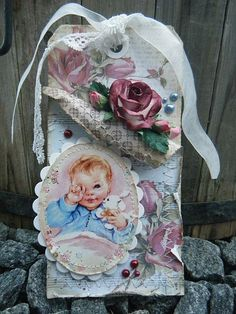 Shabby altered tag with a vintage image of a baby... So cute. love the little rose. #tags #handmade #scrapbooking #cardmaking