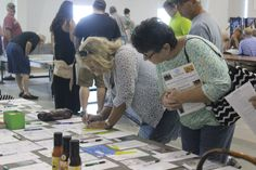 Bidding on certificates at the Boys & Girls Club celebrity Auction held in August 2016 at Trinity United Methodist Church in Greeneville, Tennessee