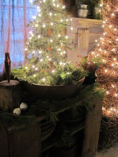 lighted tree in a wooden bowl... cute idea