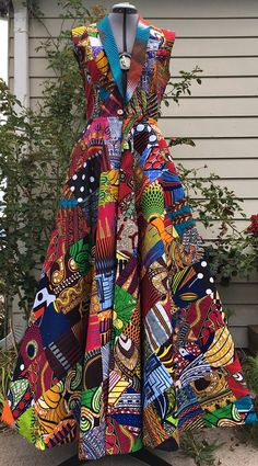 Make a Scene! Reversible African Wax Print Coat Dress Patchwork and Your Choice of Reverse Print.Truly brilliant and one of a kind piece of art! Ankara   Dutch wax   Kente   Kitenge   Dashiki   African print dress   African fashion   African women dresses   African prints   Nigerian style   Ghanaian fashion   Senegal fashion   Kenya fashion   Nigerian fashion   Ankara crop top (affiliate)