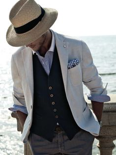 Perfect style for a day of sailing. Vest, cream sports coat, and a hat.
