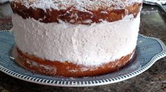 Homemade Italian lemon cream cake filled with lemon cream and topped with vanilla crumbs is just like the one at a famous Italian restaurant chain.