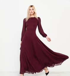 We seriously couldn't love this long-sleeved Reformation bridesmaid dress more!