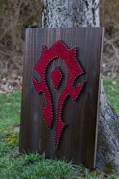 MADE TO ORDER World of Warcraft Horde String Art This item is made to order and will be ready to ship in 1-2 weeks. You will receive communication from me once complete and when your item is shipped. Made with wood, stain, nails, and string. It comes ready to hang, measures 17.5x24x2 and weighs approximately 5lbs. This item is made to order, so the design will be the same but your piece will be unique! PLEASE NOTE: Each made to order piece will look slightly different than the picture pr...
