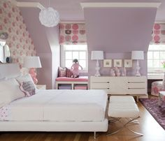 Hopefully one day we'll have a house with a bedroom like this--with the dormer window seats, not the pink and purple colors.