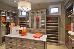 This master closet could fit a Kardashian's Wardrobe! - See more at: http://www.thehousedesigners.com/plan/dennis-5202/ #houseplan #homeplan #design #houses