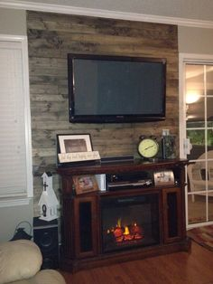 wood accent wall with tv, possibly do a dark faux finish on small wall in formal livingroom. wood accent wall with tv, possibly do a dark faux finish on small… Accent Wall Designs, Accent Wall Colors, Accent Walls, Wood Plank Walls, Wood Planks, Wall Wood, Pallet Fireplace, Fireplace Wall, Wall Behind Bed