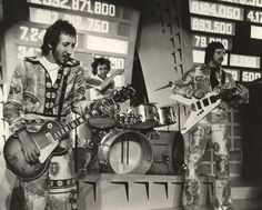 Pete Townshend, Keith Moon and John Entwistle of the rock and roll band 'The Who' perform in a still from the rock opera movie 'Tommy' which was released on March Rock And Roll Bands, Rock N Roll, The Who Band, Ken Russell, John Entwistle, Keith Moon, Best Guitar Players, Pete Townshend, Roger Daltrey