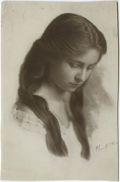 Beautiful vintage portrait of a young woman in quiet reverie.