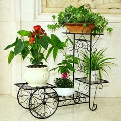 Resultado de imagen para porta maceta de hierro para jardin
