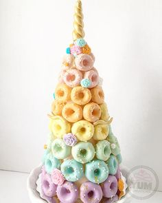 """120 Likes, 20 Comments - YUM Creations (@yum.creations) on Instagram: """"My donut tower convinced me...unicorns do exist!! Gold glittered horn and lashes, edible gold stars…"""""""
