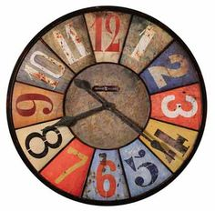 """This rustic, metal oversized gallery wall clock is over 30"""" in diameter and features an aged dial made to look old from the first day. 12 unique multi-colored panels with different arabic numerals in various styles and colors makeup the dial with a solid center disc. Quartz movement requires one AA sized battery. One year warranty and Free Shipping. <br /%3..."""
