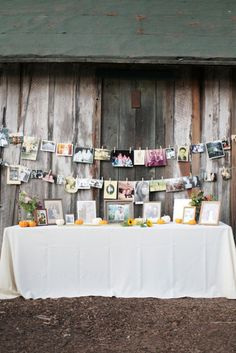 Photo display for pictures of family. A wedding I recently went to, they had old shutters hinged together, that screened off the kitchen area of the reception hall.  They had pictures of the couple and their families hung on the shutters with command strips.