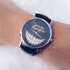 • We're All Mad Here Watch • ITEM DETAILS: • Fashion watch • Analog • Stainless steel  DISCOUNT: • On bundles • 30% off for return customers  SHIPPING: • The next day  NOTE: • Color may be slightly different from the actual item due to the lighting • Reasonable offers welcome Accessories Watches