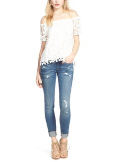 6559186ecf6f On trend  an off the shoulder neckline pared with perfectly distressed  denim. Distressed Skinny