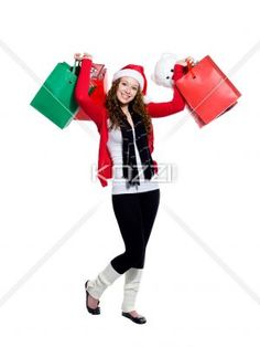 portrait of a exited young woman holding shopping bags. - Portrait of a exited young woman holding shopping bags while standing over white background, Model: Brittany Beaudoin
