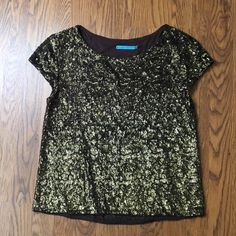 ALICE & OLIVIA SEQUIN BROWN TOP Gorgeous tee shirt top from Nordstrom. Worn a few times but it has not flaws. Very sturdy shirt. Thick sequin base and has a lining underneath. Alice + Olivia Tops Tees - Short Sleeve