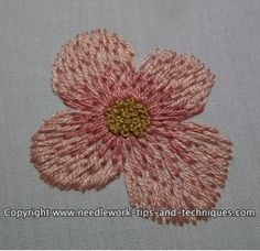 Follow along with this thread painting tutorial, and learn how to use long and short stitch to shade an embroidered flower