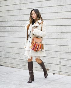 We've rounded up five boho-chic outfits that are perfect for winter. Layer an ultra-cozy shearing coat over a printed floral dress, and accessorise with suede over-the-knee boots and a fringe bag....