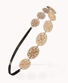 Filigree Heart Medallion Headwrap from Forever21. This would be perfect with a high curly ponytail!