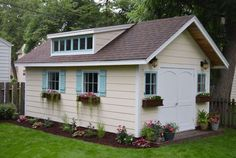 This little cottage of dreams has an adorable story behind it. These crafters were in need of a workshop and noticed their neighbor getting rid of his small unattached garage, so they inquired about it, before getting some friends and transporting the whole structure to their backyard, where they gave it a complete makeover. Neighborly interactions, a helpful gang of friends, and a cute, flowery cottage? It's almost too good to be true!