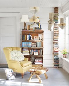 Erin devoted one corner of the enclosed porch to reading, complete with a vintage chair and a saddle-topped foot-stool. Classics like Little House on the Prairie and The Hardy Boys share space with more modern titles like the Harry Potter series.