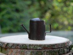 Miniature fairy garden watering can. $1.75, via Etsy.
