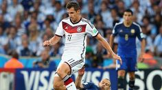 Javier Mascherano of Argentina (14) tackles Miroslav Klose of Germany (11).