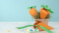 Carrot Treat Bags: Using our simple template, you can create these easy treat bags with just some paper, tape, and ribbon.