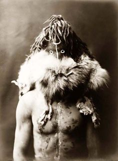 Here for your browsing pleasure is a grand photo of Haschezhini. It was made in 1904 by Edward S. Curtis.    The photo presents a Navajo Indian, half-length portrait, facing front, wearing dark leather mask, fur ruff, and with an exposed torso painted with black and white splotches.    We have compiled this collection of photos mainly to serve as a vital educational resource. Contact curator@old-picture.com.    Image ID# 7EA8D03F