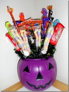 Halloween candy bouquet: I like the idea of this, different candies though! maybe a smaller container