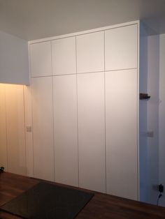 Painted white matt wardrobe with plain push open doors. White Hallway, Alcove Wardrobe, Built In Cupboards, Storage Furniture Bedroom, Painted Wardrobe, Foyer Storage, Built In Wardrobe Doors, Wardrobe Shelving, Wardrobe Doors
