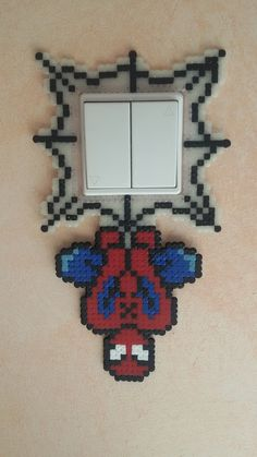 Spiderman light switch cover perler beads by groslip1255 on deviantART - Pattern: http://www.pinterest.com/pin/374291419006336611/
