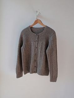 """Jamie Cardigan by Janice Straker in 5ply Round-neck cardigan with twisted rib shoulders and 'tree-of-life"""" panels on a stockinette background. This is a 2003 pattern and perhaps the sleeve cap would need to be tweaked but really like this!"""