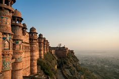 The Man Mandir Palace at the Gwalior Fort in Madhya Pradesh was built by Raja Man Singh Tomar around 1500; it's an incredible sight with its monumental walls accented with shimmering blue and yellow tiles and topped with copper-and-gold chhatris.