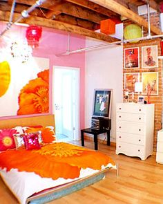 The decor above the bed is actually a table cloth stretched onto a wood frame like canvas art.
