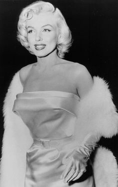 Marilyn photographed at the Call Me Madam premiere, 1953.